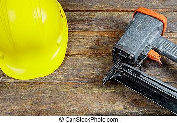 Brad nail gun air nailer tool and helmet for construction