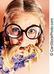 c925dd99d7 Smart girl. Portrait of a funny blonde girl in big round spectacles ...