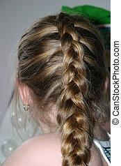 A little girls french hair braid.