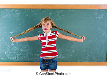 Braided student blond girl playing with braids