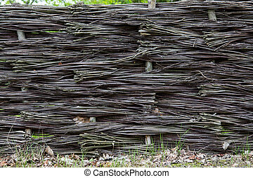 Braided wicker fence in the countryside