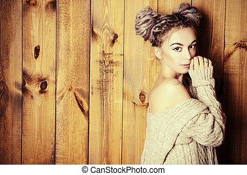 braids hairdo - Beautiful young woman with dreadlocks...