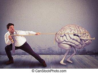 Brain drain - Man pulls the rope with brain drain
