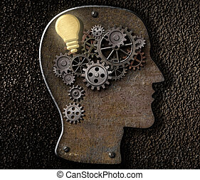 Brain mechanism made from metal cogs and gear with idea bulb...