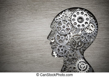 Brain model concept made from gears and cogwheels on wooden background