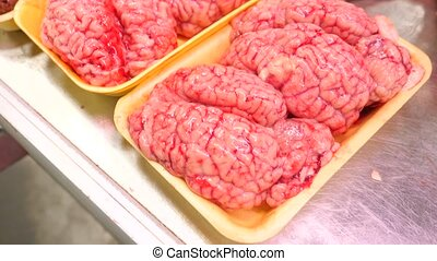 Brain of a cow over in the showcase of the meat market,...