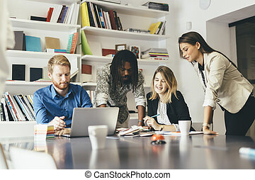 Brainstorming colleagues in office