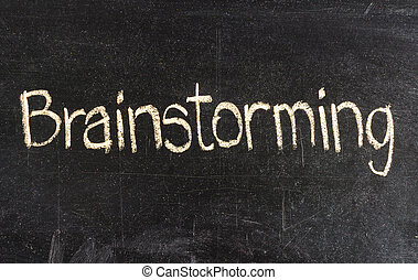 Brainstorming handwritten with white chalk on a blackboard