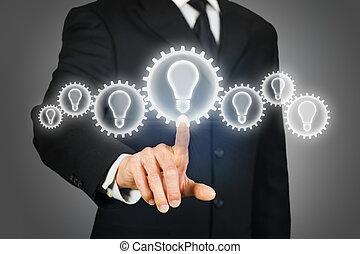 Brainstorming idea - Businessman clicking on a virtual...
