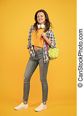 Brainy is new sexy. Happy student yellow background. University student carry backpack. Pretty student smile in casual wear. Senior high student. Girl back to school. University. Higher education