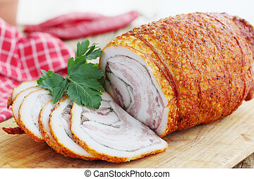 braised bacon with pepper - fat with spices rolled and baked...