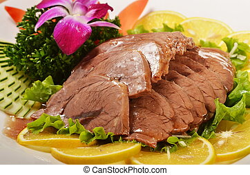 Sliced braised beef shank Served with lemon and flower