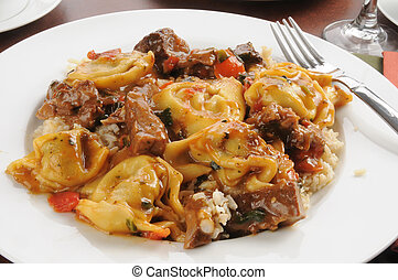 Braised beef tips with tortellini stuffed with portabello...