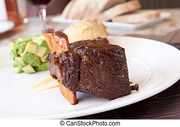 Short rib, cooked to perfection, served with savoury pound cake, avocado cubes, turnip puree and county cider reduction.