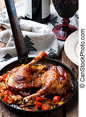 Braised Duck Legs with vegetables. style rustic. selective ...