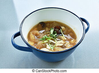 braised fish maw with black mushroom in red gravy topping crab meat in pot
