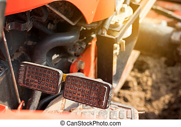 Brake and accelerator pedal for tractor.