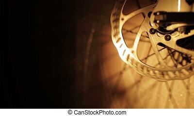 Brake disc on a bicycle wheel spinning