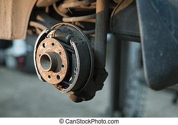 Brake drum in car repair shop