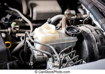 Brake fluid reservoir with the cap removed - Pickup engine...