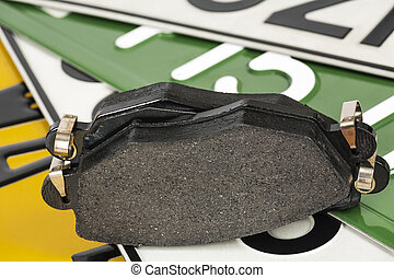 Brake pads and license plates