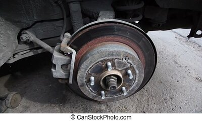 Brake shoes in empty wheel place, closeup view in motion