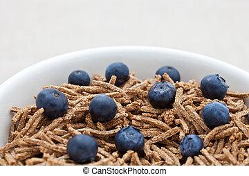 Bran breakfast cereal with blueberries