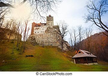 Bran Castle (Dracula castle) with house nearby in Transylvania and Wallachia, Romania