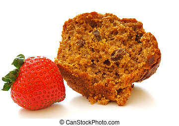 Half of a bran muffin that has been split open and a fresh whole strawberry lying on it's side