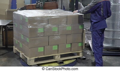 Branch of boxes are being packed with polyfirm on the plant.