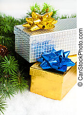 branch of Christmas tree with gift boxes