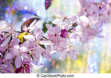 branch of decorative cherry with pink flowers