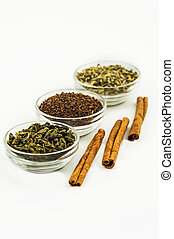 branch of green tea, cinnamon, spices isolated