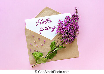 Branch of lilac on craft envelope with empty card