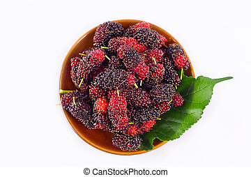 branch of ripe mulberry fruit and mulberry leaf  in brown bowl on white background healthy mulberry fruit food isolated