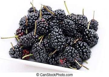 ripe mulberry fruit in bowl