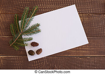 Branch with pine cones on the paper