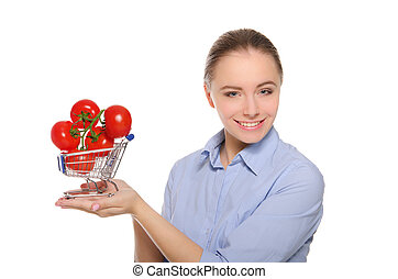 branch with tomatoes in trolley on the women palm