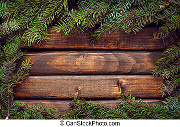 Branches of a Christmas tree on old boards. Christmas background. New Year background. Xmax background. Toning antique.