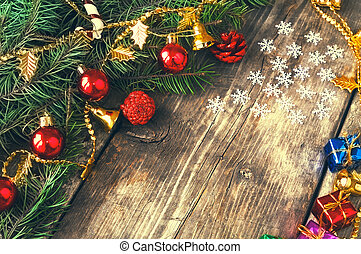 Branches of a Christmas tree on old boards. Christmas background. New Year background. Xmax background.