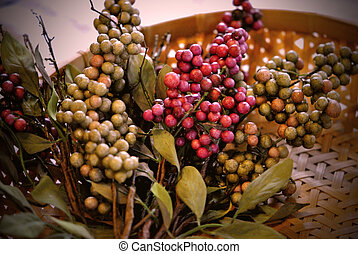 Branches of berries in a basket.