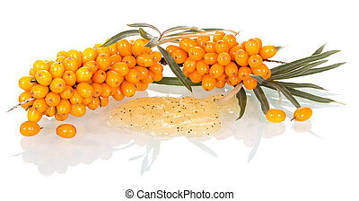 Branches with berries of sea-buckthorn and natural face scrub isolated on white.