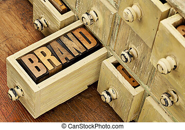 brand word concept - brand word in vintage letterpress wood ...
