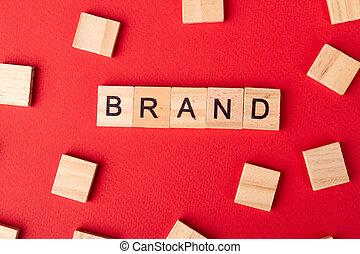 Brand word written on wood block.