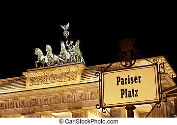 Brandenburg Gate And Sign At Night