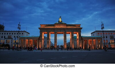 Brandenburg gates in Berlin with crowd and urban transport timelapse