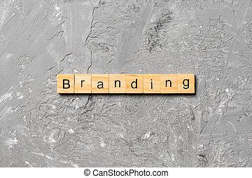 branding word written on wood block. branding text on table, concept