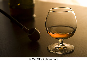 Brandy and pipe II - A glass with some brandy and pipe.