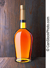 Brandy bottle on wood
