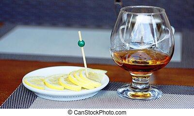 Brandy with lemon.